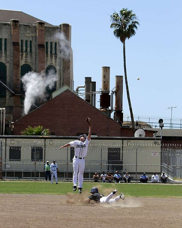 San Rafael Pacifics shortstop Danny Gonzalez leaps for a ball as San Quentin player Carlye Blake slides safely into second. Photo: Michael Macor, The Chronicle