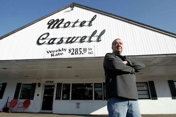 FILE -In this Wednesday, Nov. 9, 2011 file photo, owner Russ Caswell stands outside his Motel Caswell in Tewksbury, Mass. Caswell is fighting to keep the federal government from taking his motel under a law that allows for forfeiture of properties connected to crimes. The government does not claim that Caswell committed any crimes, but claims there is drug-dealing among the motel's guests.