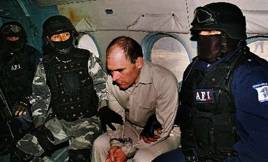 "Another large grab involved Mexican cartel leader Osiel Cardenas Guillen. In 2010 Houston-based prosecutors struck a plea deal with the 42-year-old former car thief who long led Mexico's powerful Gulf Cartel. Cardenas agreed to hand over $50 million in assets as part of his sentencing.By 2012, the government already had distributed $29.5 million of the loot to Texas law enforcement agencies, among them Cameron County Sheriff Omar Lucio who told Hearst newspapers he's already spent most of his $5.9 million federal check on 13 more officers, two ""sniffer dogs,"" vehicles, upgraded weapons and raises for everyone in the department that patrols the area closest to Cardenas' former stronghold in Matamoros.Cardenas Guillen, center, is pictured during his extradition to Houston from Mexico in January 2007."