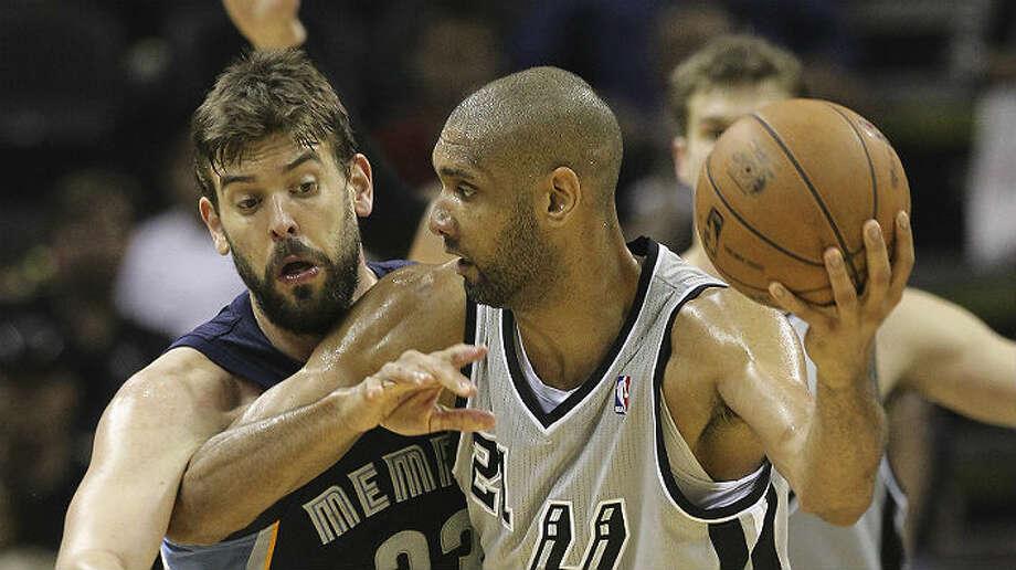 Tim Duncan is averaging 17.5 points and 9.3 rebounds per game in this postseason. Kin Man Hui / San Antonio Express-News