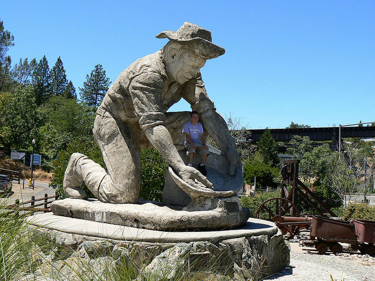 Gold miner statue, Placerville Going for gold: This 45-ton concrete statue in Auburn commemorates Claude Chana, who discovered gold in a nearby ravine in 1848. A local dentist known for his mammoth statues created the landmark, found not far from I-80, in 1975.