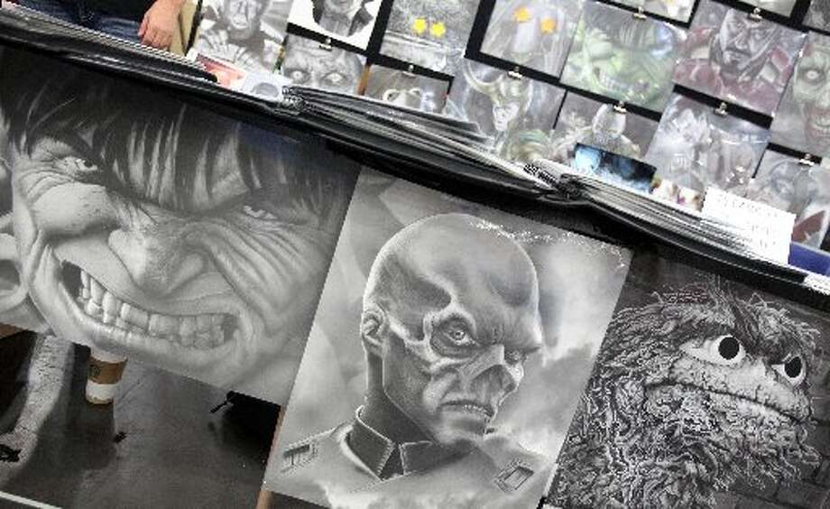 Artist display work during the ComicPalooza.