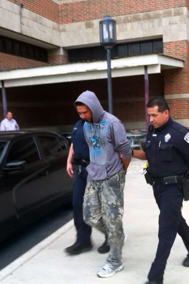 Murder suspect Stephen Bailey, 28, is escorted to the city magistrate's office on Friday, May 24, 2013. Photo: Ana Ley / Express-News