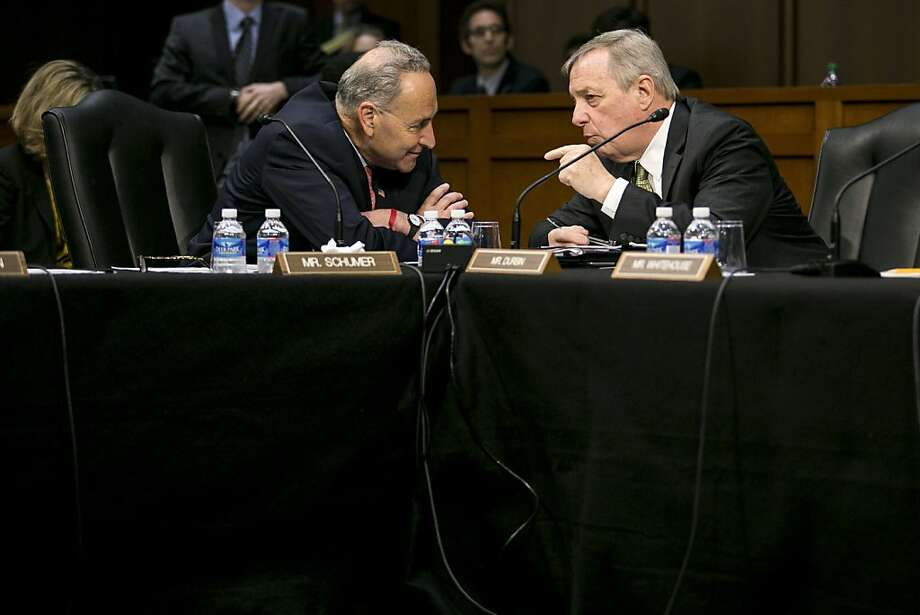 Sens. Chuck Schumer, D-N.Y. (left), and Dick Durbin, D-Ill., confer Monday at a meeting. Photo: Drew Angerer, New York Times