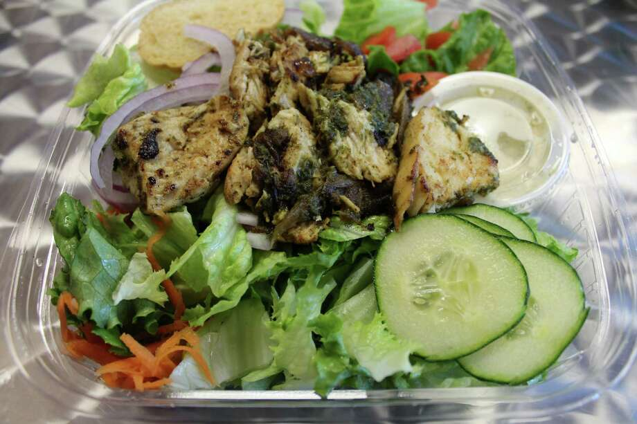 The Greek salad at Herb & Pickle comes with greens, tomato, cucumber, red onions, carrots, kalamata olives and feta cheese topped with grilled pesto chicken and served with pepperoncini dressing.