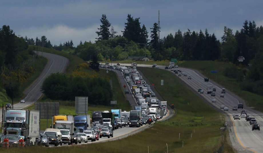 Northbound Interstate 5 traffic coming into Mount Vernon is backed up for about 10 miles at the kickoff of the Memorial Day weekend, the day after the Interstate 5 bridge over the Skagit River between Mt. Vernon and Burlington collapsed into the river. Three people were rescued after two cars and a travel trailer fell into the cold water. There were no known fatalities. Photo: JOSHUA TRUJILLO, SEATTLEPI.COM / SEATTLEPI.COM