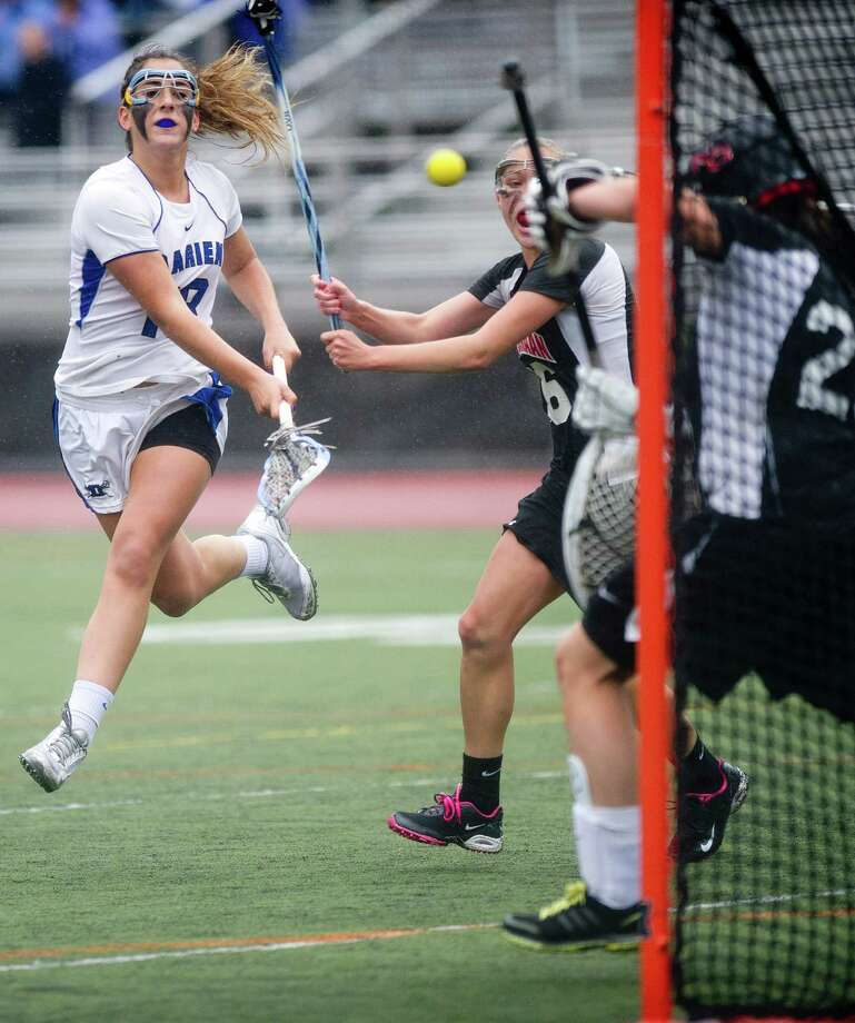 Darien's Jena Fritts takes a shot during Friday's girls lacrosse FCIAC Championship game against New Canaan at Brien McMahon High School in Norwalk, Conn., on May 24, 2013. Photo: Lindsay Perry / Stamford Advocate