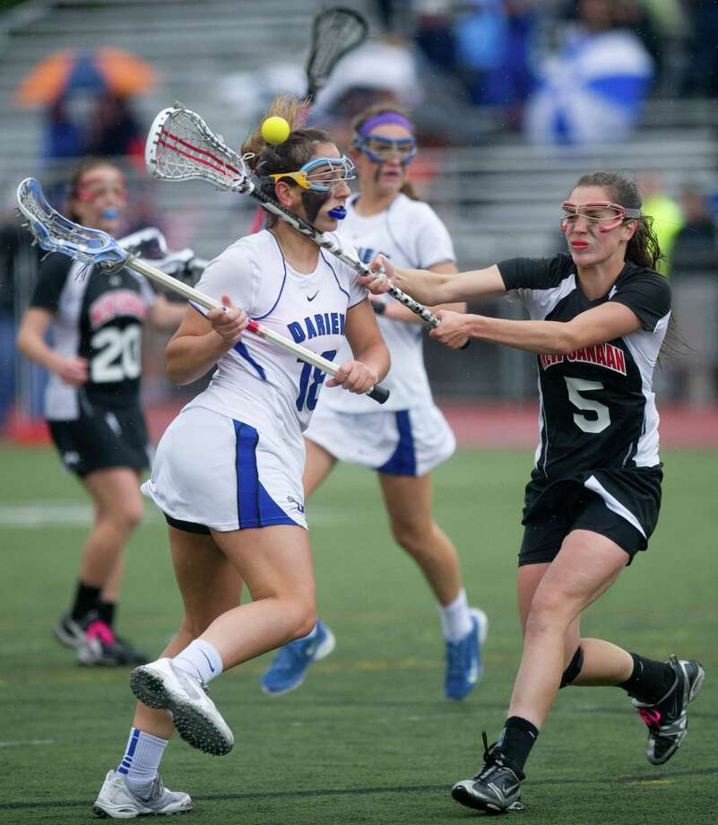 Darien's Jena Fritts is defended by New Canaan's Biranna McEwan during Friday's girls lacrosse FCIAC Championship game at Brien McMahon High School in Norwalk, Conn., on May 24, 2013. Photo: Lindsay Perry / Stamford Advocate