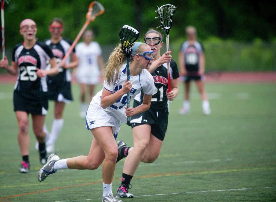Darien's Hollis Perticone carries the ball during Friday's girls lacrosse FCIAC Championship game against Darien at Brien McMahon High School in Norwalk, Conn., on May 24, 2013. Photo: Lindsay Perry / Stamford Advocate