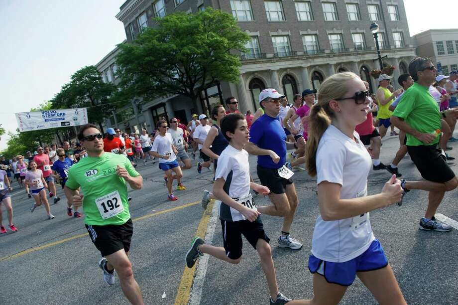 The 48th annual Jim Fixx Greenwich Memorial Day Road Race sets off down Greenwich Avenue in Greenwich, Conn., May 28, 2012. Photo: Keelin Daly / Stamford Advocate