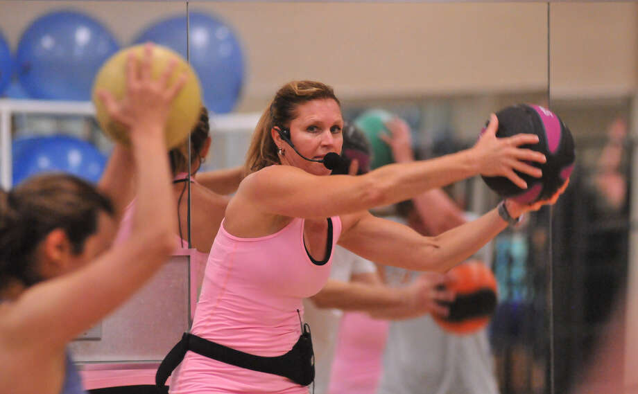 Strength training: Some studies suggest HIIT helps the body burn fat post-workout and leave people feeling less hungry. Photo: Photos By Robin Jerstad / For The Express-News