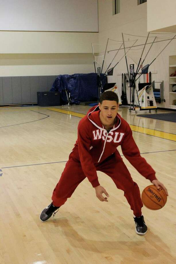 Klay Thompson's Swagga Suit is roomy enough for some dribbling moves.
