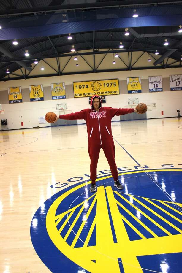 Klay Thompson shows off his WSU Swagga Suit and his big hands.