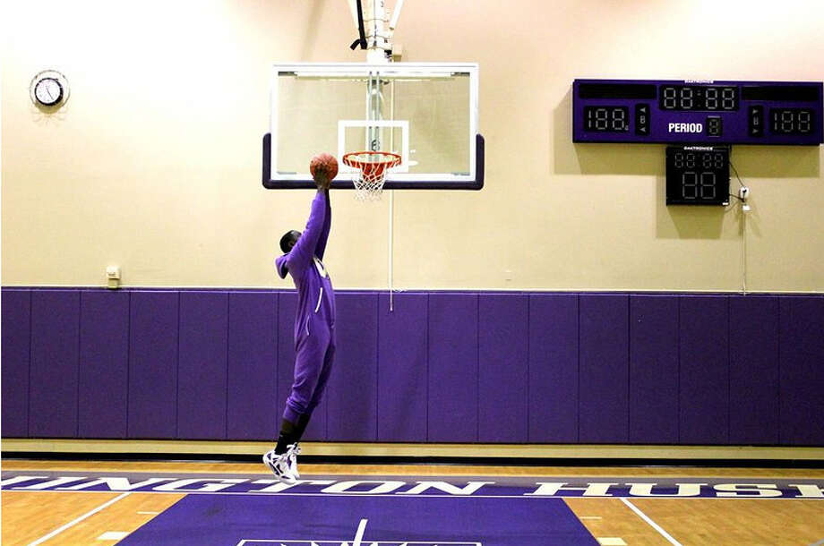 Former Huskies star Darnell Gant goes up for a dunk in his roomy Swagga Suit.