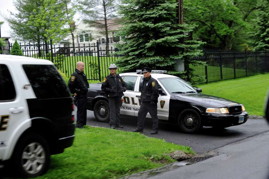 Norwalk Police, called in to assist the Ridgefield Police, guard the front gate of a home at 423 Ridgebury Rd in Ridgefield, Conn. where a shooting occurred Friday evening, May 24, 2013. Photo: Carol Kaliff / The News-Times