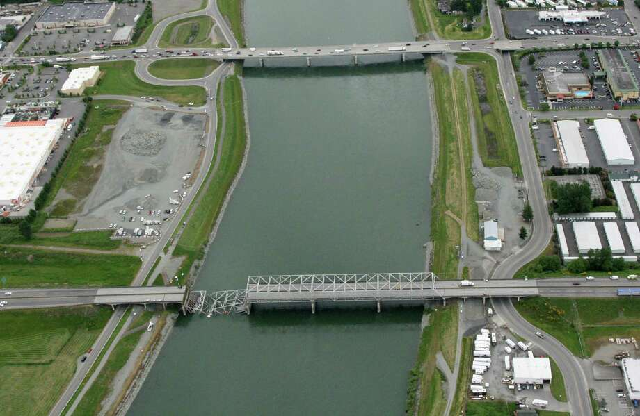 In this photo provided by WSDOT, the destroyed north end of the Interstate 5 bridge over the Skagit River is shown. The bridge at top is the Riverside Drive bridge, one of the alternate routes around the closed Interstate. Photo: WSDOT Photo, SEATTLEPI.COM / SEATTLEPI.COM