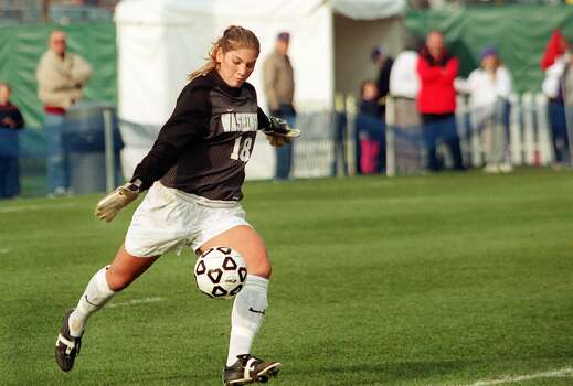 UW Huskie goalie Hope Solo returns the ball in the second half of a game against Montana on Nov. 12, 2000. Photo: Daniel Sheehan, Seattle P-I File