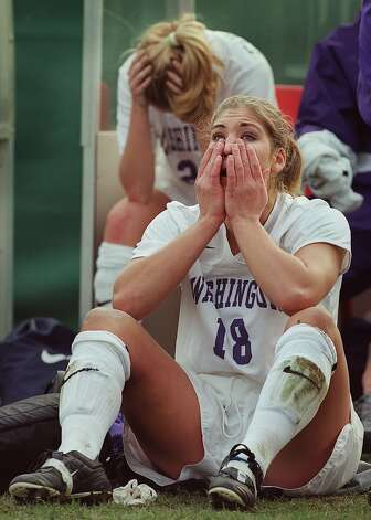 Washington Huskies goalkeeper and forward Hope Solo wipes back tears after her team's loss to Portland in third round of the NCAA Women's College Cup soccer tournament on Nov. 19, 2000. Photo: Dan DeLong, Seattle P-I File