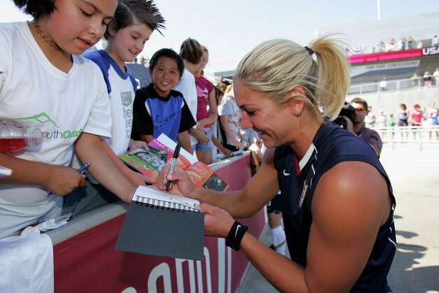 Goalkeeper Hope Solo of the United States signs autographs after playing Brazil at Dick's Sporting Goods Park on July 13, 2008, in Commerce City, Colorado. The United States defeated Brazil 1-0. Photo: Doug Pensinger, Getty Images / 2008 Getty Images