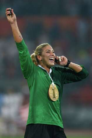 Hope Solo of United States celebrates as she speaks on the phone after winning the Women's Football Gold M
