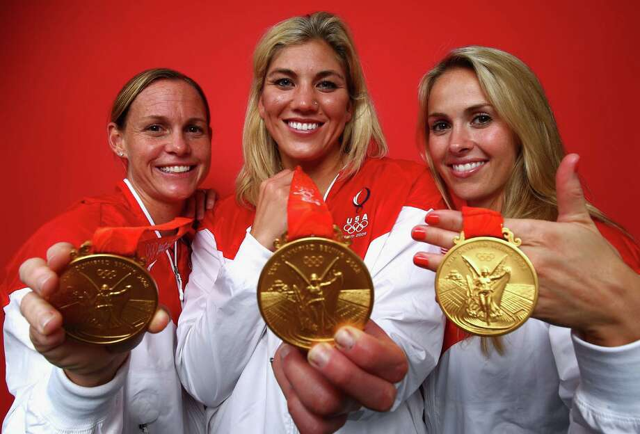 "From left to right: Christie Rampone, Hope Solo and Heather Mitts of the United States pose in the NBC ""Today"" show studio as part of the Gold Medal winning Women's Football Team at the Beijing 2008 Olympic Games on August 22, 2008, in Beijing, China. Photo: Ryan Pierse, Getty Images / 2008 Getty Images"