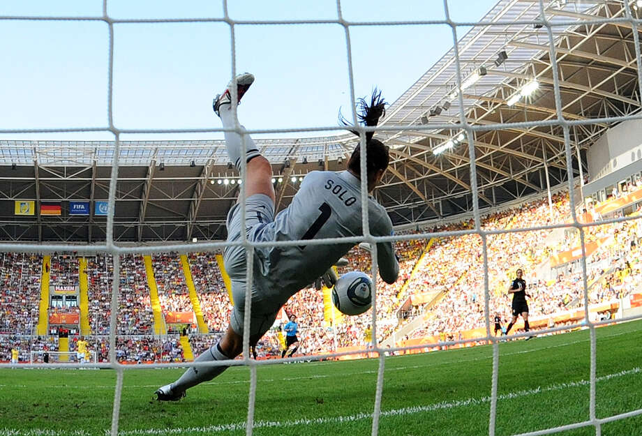 USA's goalkeeper Hope Solo saves a ball during the quarter-final match of the FIFA women's football World Cup Brazil vs USA on July 10, 2011, in Dresden, eastern Germany. The USA won the match after a penalty shoot-out. Photo: ROBERT MICHAEL, AFP/Getty Images / 2011 AFP