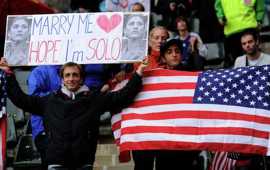 "A USA supporter holds a placard reading ""Marry me, Hope, I'm Solo"" -- refering to US goalkeeper Hope Solo -- during the FIFA women's football World Cup semi-final match France vs USA in Moenchengladbach, western Germany, on July 13, 2011. Photo: PATRIK STOLLARZ, AFP/Getty Images / 2011 AFP"