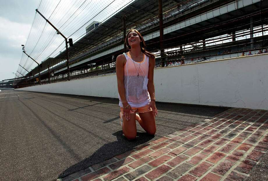 American soccer goalkeeper Hope Solo gets ready to kiss the bricks at Indianapolis Motor Speedway on July 30, 2011, in Indianapolis, Indiana. Photo: Tom Pennington, Getty Images For NASCAR / 2011 Getty Images