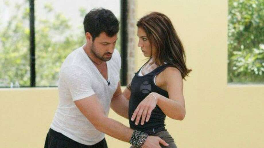 "Hope Solo and partner Maksim Chmerkovskiy rehearse for the two-hour season premiere of ""Dancing with the Stars."" Photo: ABC Photo"