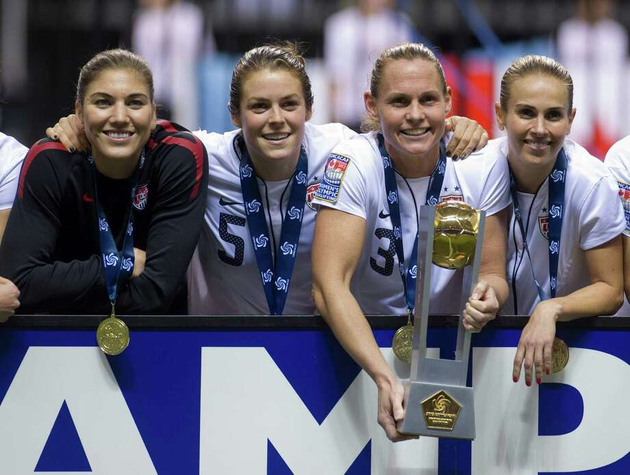 From left: Goalkeeper Hope Solo, Kelley O'Hara, Christie Rampone and Heather Mitts of the United States pose for a photo after defeating Canada in the championship game of the 2012 CONCACAF Women's Olympic Qualifying Tournament at BC Place on Jan. 29, 2012, in Vancouver, British Columbia, Canada. The United States and Canada qualified for the 2012 Summer Olympic Games in London. Photo: Rich Lam, Getty Images / 2012 Getty Images