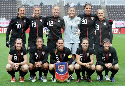 Front row, left to right: US players midfielder Heather O'Reilly, midfielder Shannon Boxx, defender and captain Christie Rampone, midfielder Kelley O'Hara and defender Amy Lepeilbet. Back row, left to right: Midfielder Carli Lloyd, forward Alex Morgan, forward Lauren Cheney, goalkeeper Hope Solo, forward Abby Wambach and defender Rachel Buehler, pose in a photo session prior to their three-nation Kirin Challenge Cup football match against Brazil in Chiba on April 3, 2012. USA beat Brazil by 3-0. Photo: TOSHIFUMI KITAMURA, AFP/Getty Images / 2012 AFP