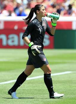 Goalkeeper Hope Solo of the USA takes a drink during a game against Canada during the second half of the women's Olympic send-off soccer match June 30, 2012, at Rio Tinto Stadium in Sandy, Utah. The US beat Canada 2-1. Photo: George Frey, Getty Images / 2012 Getty Images