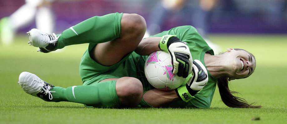 US goalkeeper Hope Solo reacts after a challenge during a Olympic Women's scocerl match against France at Hampden Park, Glasgow, Scotland, on July 25, 2012. Photo: Graham Stuart, AFP/Getty Images / 2012 AFP