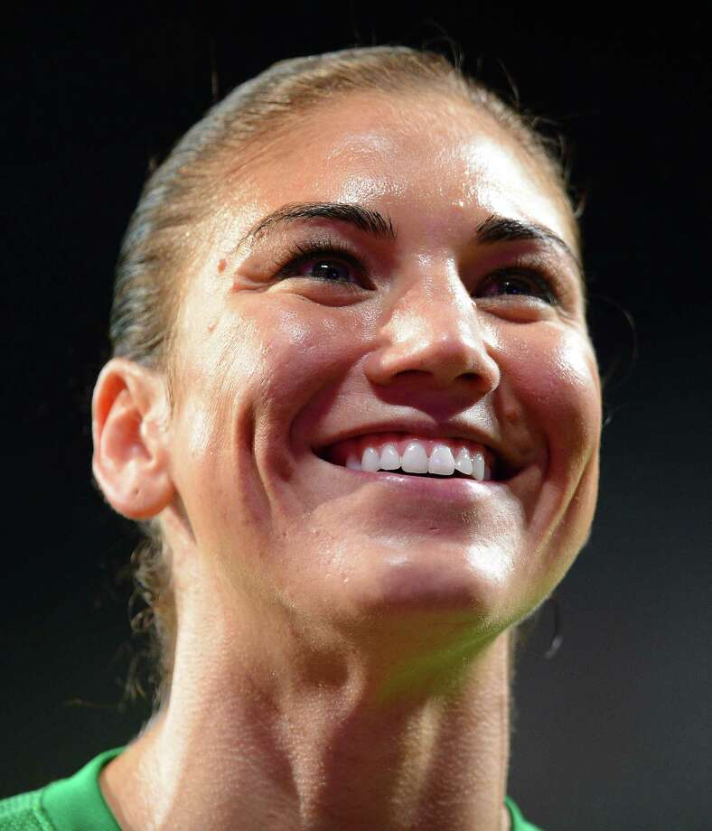 US goalkeeper Hope Solo reacts after the US won 4-3 during the London 2012 Olympic Games women's semifinal soccer match between the US and Canada at Old Trafford in Manchester, northwest England on Aug. 6, 2012. Photo: Andrew Yates, AFP/Getty Images / 2012 AFP