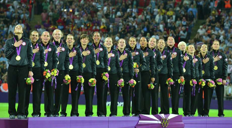 Gold medalist Team USA pose on the podium of the women's soccer competition of the London 2012 Olympic Games on Aug. 9, 2012, at Wembley stadium in London. Team USA won gold, while Team Japan took silver and Team Canada got bronze. Photo: Martin Bernetti, AFP/Getty Images / 2012 AFP
