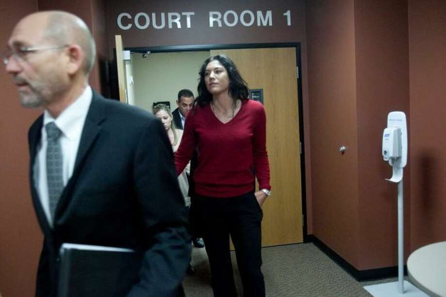 Soccer star Hope Solo leaves a courtroom with her lawyer Peter Offenbecher, left, after a bail hearing for former Seahawks player Jerramy Stevens. Stevens appeared in Kirkland, Wash.,  Municipal Court on Nov. 13, 2012, for a domestic violence probable cause hearing. He was released without conditions by the judge who didn't find probable cause to hold him. Photo: Joshua Trujillo, Seattlepi.com