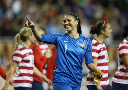 Hope Solo of Team USA waves to fans after a game against China at Ford Field on December 8, 2012, in Detroit, Michigan. USA defeated China 2-0. Photo: Leon Halip, Getty Images