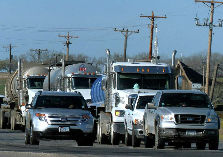 Truck traffic related to the Eagle Ford Shale energy boom travels through Kenedy. Photo: Billy Calzada, Staff / San Antonio Express-News
