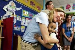 Eyoab Ashagari, 4, gives KIPP Sharp preparatory school principal Alma Salman a hug as she visits his pre-kindergarten class.  The 41,000-student Knowledge is Power Program is taking its methods worldwide.