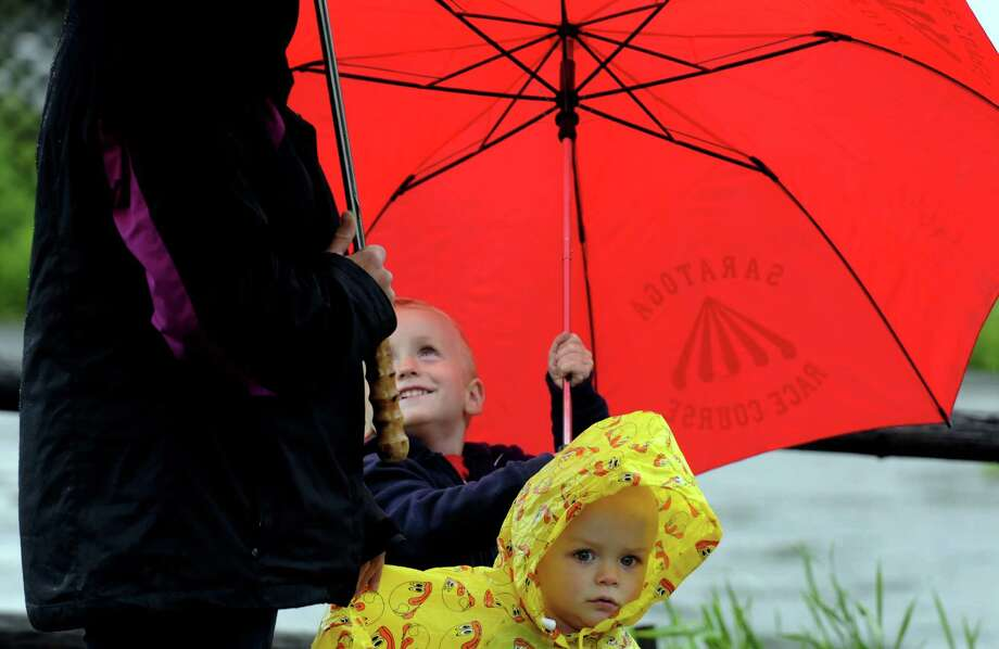 Two-year-old Luke Stewart, right, and his brother Grant Stewart watch the Village of Stillwater Memorial Day Parade on Friday May 24, 2013 in Stillwater, N.Y. (Michael P. Farrell/Times Union) Photo: Michael P. Farrell