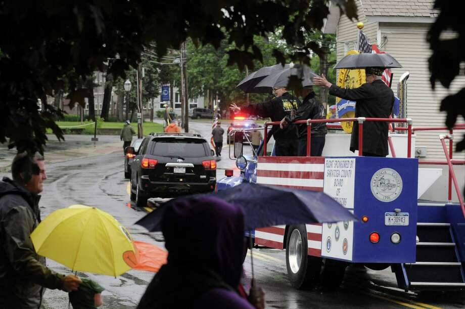 A crowd mostly clad in rain gear or under umbrella cover watch the Village of Stillwater Memorial Day Parade on Friday May 24, 2013 in Stillwater, N.Y. (Michael P. Farrell/Times Union) Photo: Michael P. Farrell