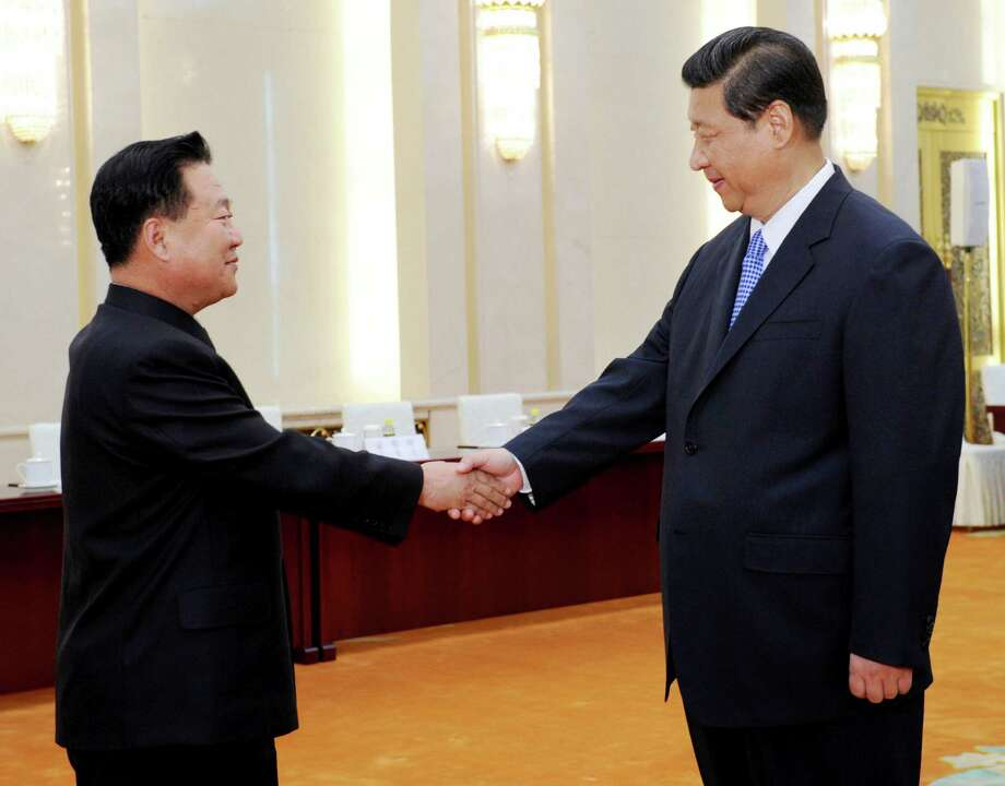 In this photo released by China's Xinhua News Agency, Chinese President Xi Jinping, right, greets North Korean Vice Marshal Choe Ryong Hae in Beijing Friday, May 24, 2013. The top North Korean envoy delivered a letter from leader Kim Jong Un to Xi on Friday and told him Pyongyang would take steps to rejoin stalled six-nation nuclear disarmament talks, in an apparent victory for Beijing's efforts to coax its unruly ally into lowering tensions. (AP Photo/Xinhua, Rao Aimin) NO SALES Photo: Rao Aimin