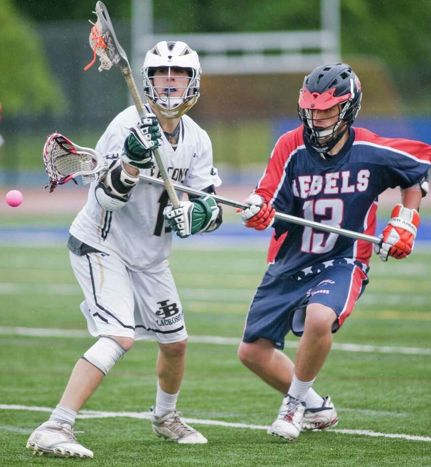 Joel Barlow High School's Kyle Gambino and New Fairfield High School's John Pendergast battle for the ball in the SWC Division I boys lacrosse final played at Brookfield High School. Friday, May 24 2013 Photo: Scott Mullin / The News-Times Freelance