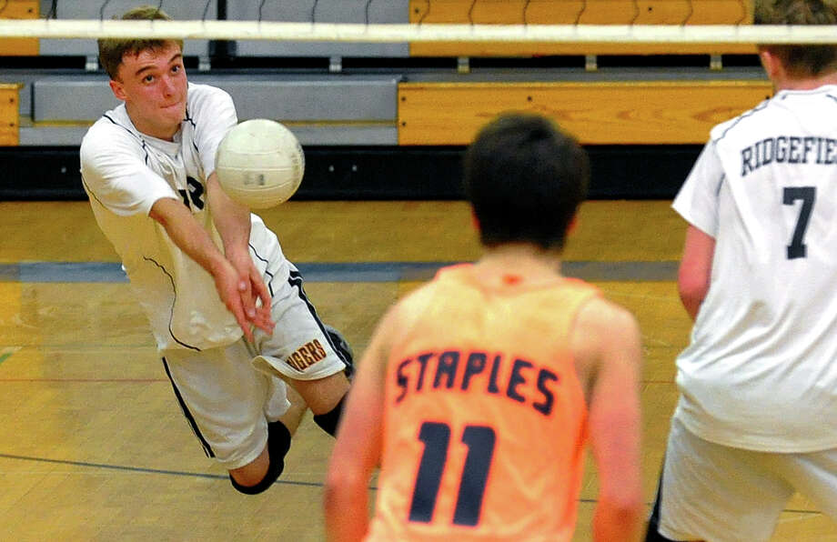 Ridgefield's Tyler Chittenden tries to keep the ball in play, during FCIAC Boys' Volleyball Championship game action against Staples at Fairfield Ludlowe High in Fairfield, Conn. on Friday May 24, 2013. Photo: Christian Abraham / Connecticut Post