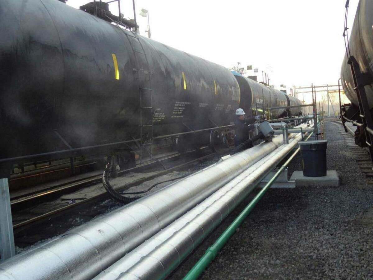Heated heavy Canadian oil is transferred from rail cars into pipelines for processing at a NuStar Asphalt joint-venture refinery in Paulsboro, N.J.