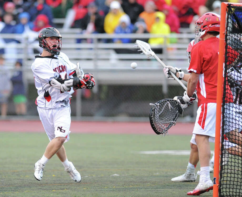 New Canaan's Peter Richardson (# 18) scores during the FCIAC boys high school lacrosse championship match between Greenwich High School and New Canaan High School at Brien McMahon High School in Norwalk, Friday night, May 24, 2013. New Canaan took the title defeating Greenwich, 8-5. Photo: Bob Luckey / Greenwich Time
