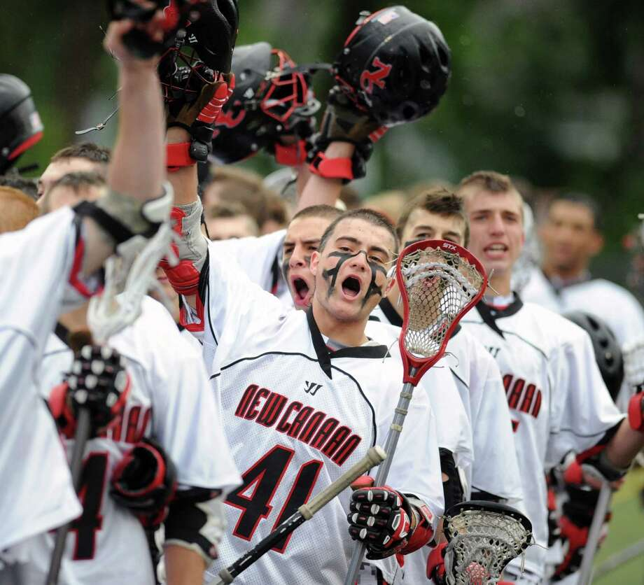 Frank Cognetta (# 41) of New Canaan leads the cheer at the start of the FCIAC boys high school lacrosse championship match between Greenwich High School and New Canaan High School at Brien McMahon High School in Norwalk, Friday night, May 24, 2013. New Canaan took the title defeating Greenwich, 8-5. Photo: Bob Luckey / Greenwich Time