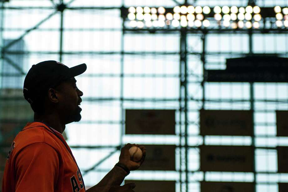 Los Angeles Clippers center DeAndre Jordan looks out over the stadium as he takes a few warmup tosses before throwing out the ceremonial first pitch before the Houston Astros face the Oakland Athletics at Minute Maid Park on Friday, May 24, 2013, in Houston. Photo: Smiley N. Pool, Houston Chronicle / © 2013  Smiley N. Pool