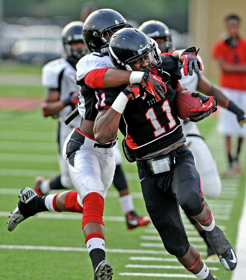 Port Arthur wide receiver Roderic Rucker, #11, charges down the sideline and is tackled by CJ Levine, #13, during the Port Arthur Memorial High School spring game on Friday, May 24, 2013, in Port Arthur. Photo taken: Randy Edwards/The Enterprise Photo: Randy Edwards