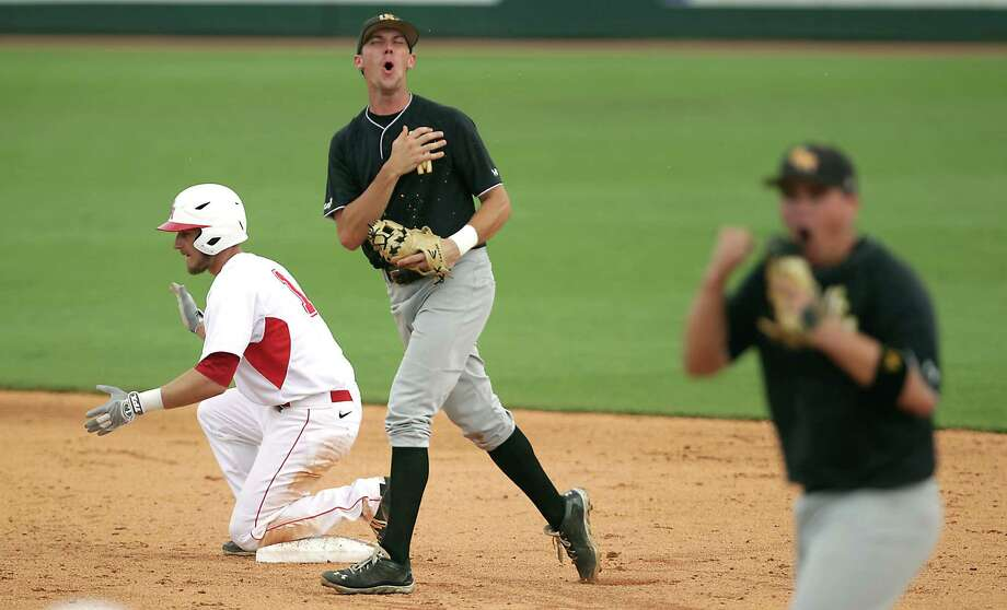 UH's Landon Appling, left, reaches second base safely in the third inning Friday, much to the dismay of Southern Mississippi's Jake Drehoff and Tim Lynch. Photo: James Nielsen, Staff / © 2013  Houston Chronicle